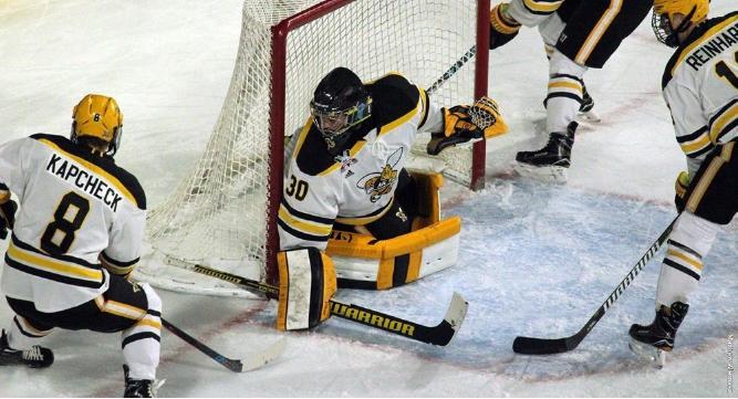 AIC hockey team competing against Umass