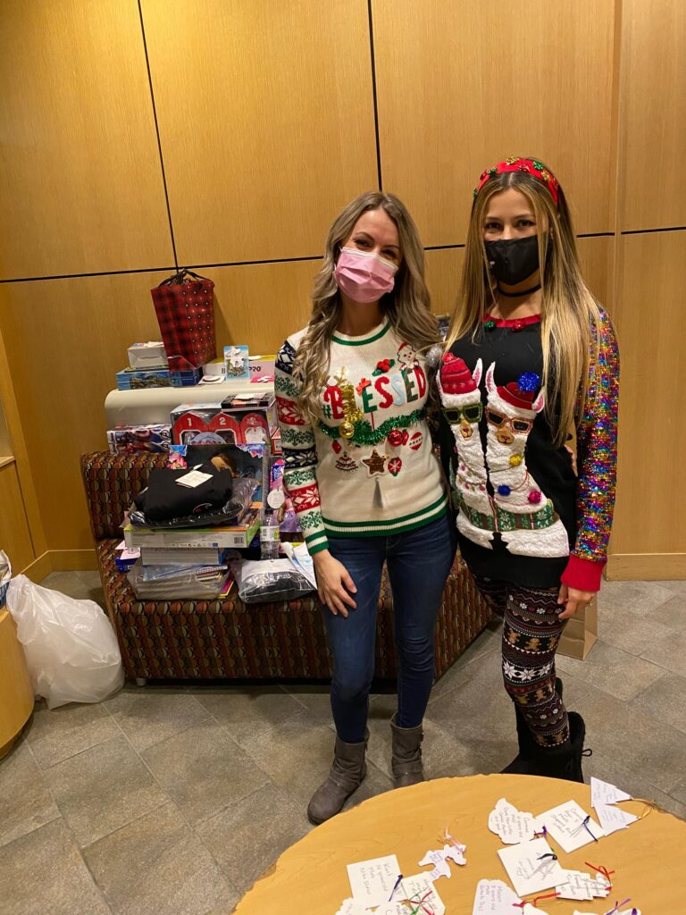 AIC Student Nurse Association Co-Presidents Estera Janik (left) of Springfield, MA and Andrea Mazzarella of East Granby, CT ready to deliver donated toys for foster children with CHD.