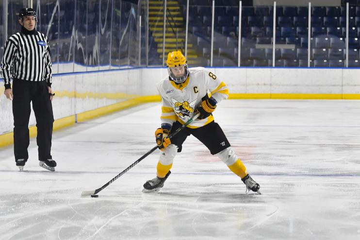 AIC hockey player Brennan Kapcheck